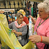 Marilyn Dyer, left, of St. Timothy-Troy Lutheran Church, Renselaer, N.Y., looks at a scarf at Studio Three 17, owned by Norma Colman, Berryville, Va. Norma designs, paints and prints the scarves. JV
