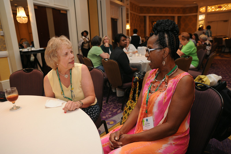 Ninth Triennial Gathering | Ely Smith, treasurer for Women of the ELCA's churchwide boarrd, and Charleen Walker-Horton, outgoing board member, chat during the international guest reception.