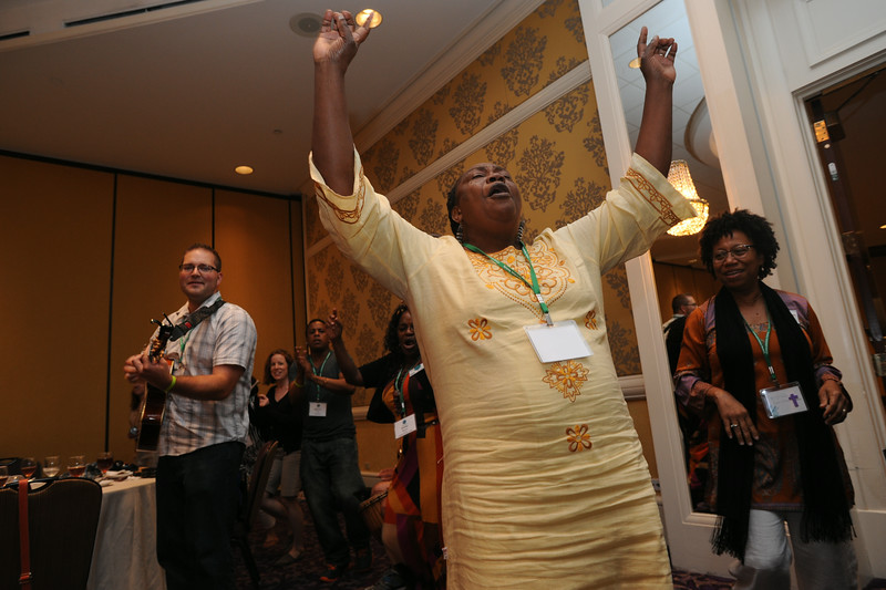 Ninth Triennial Gathering |  Sara Lomayani from Tanzania, North Central Diocese, begins to feel the music at the international guest reception at the Ninth Triennial Gathering in Charlotte, N.C., July 26.