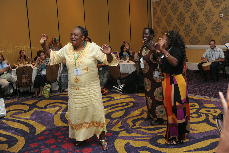 Ninth Triennial Gathering | Sara Lomayani from Tanzania, North Central Diocese, feels the music at the international guest reception at the Ninth Triennial Gathering in Charlotte, N.C., July 26.