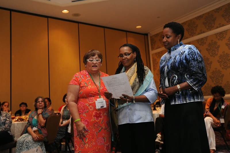 Ninth Triennial Gathering | Raquel Rodriguez, Val Starr, and Tammi Jackson, Global Mission, lead a litany.