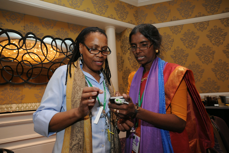 Ninth Triennial Gathering | Val Starr, left, director of discipleship for Women of the ELCA, shows Veronica Angela Sathuri of Andhra Evangelical Lutheran Church, India, a photo on her iPhone.