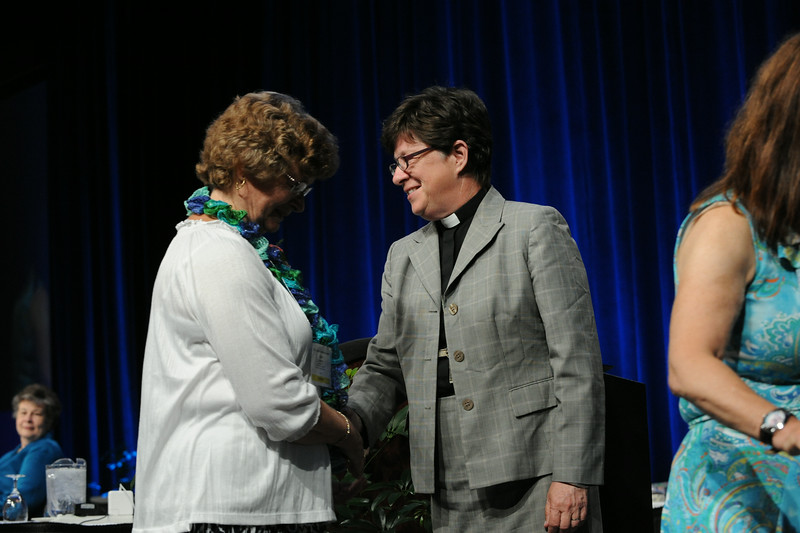 Ninth Triennial Convention | Presiding Bishop Elizabeth Eaton, r, congratulates Joan Iverson on being re-elected to the executive board. JV