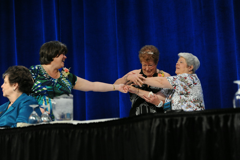 Ninth Triennial Convention | Outgoing executive board officers Jenny Michael, left, Jackie Wilson, and JoAnn Fuchs are playful as they relinquish their positions. JV