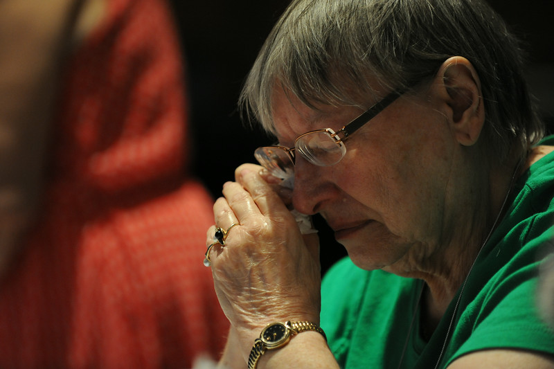 Ninth Triennial Convention | Charlotte Sherma, Good Oak Lutheran Church, Garden City, Mich., tearfully prays in the final plenary of the Ninth Triennial Convention in Charlotte, N.C. JV