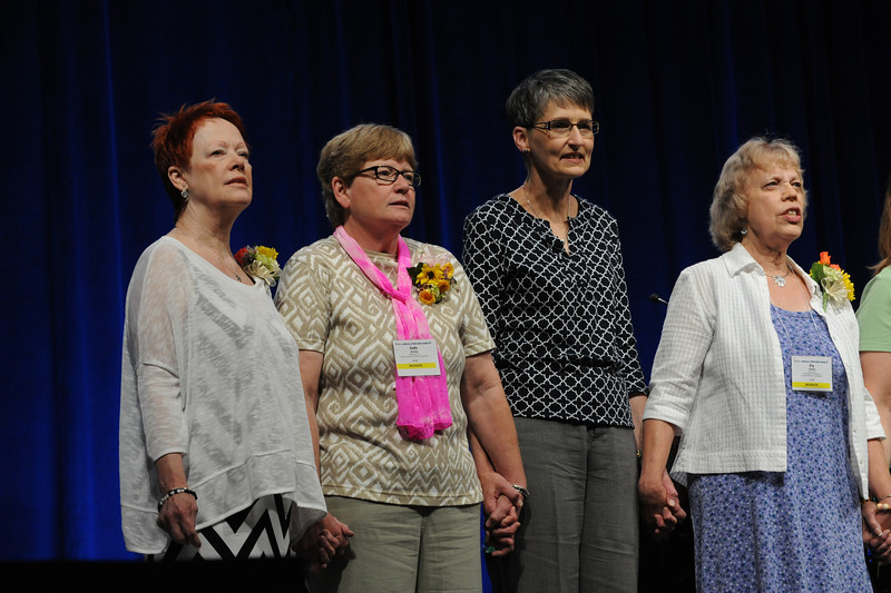 Ninth Triennial Convention | The newly elected officers of the executive board, l-r,  Patti Austin, president; Jody Smiley, vice president; Becky Shurson, secretary; and Ely Smith, treasurer, are presented for installation by the presiding bishop.
