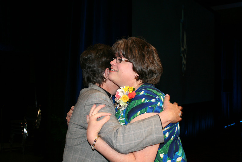 Ninth Triennial Convention | Bishop Eaton and Jenny Michael, former churchwide executive board, embrace after the close of convention.