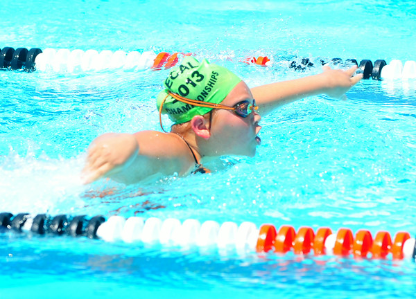 Lamarlins swimmer Makayla Torres competes in the 11-12 50 yard butterfly during the Valley Championships held at the Lamar Swimming Pool over the weekend.