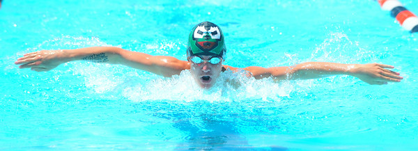 Lamarlins swimmer Jesse Rogers competes in the 13-14 Boys 100 Yard Butterfly during the Valley Championships held at the Lamar Swimming Pool over the weekend.