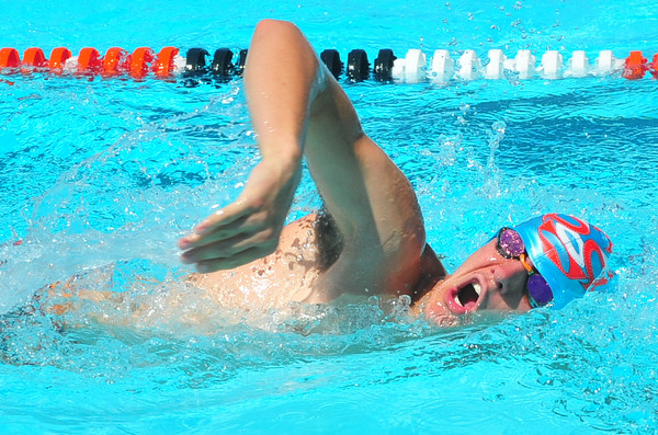 Lamarlins swimmer Jake Rogers competes in the Boys Open 100 Yard Freestyle during the Valley Championships held at the Lamar Swimming Pool over the weekend.
