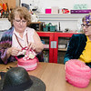 Marjorie Powell and Karen Sargent put the finishing touches on her hat during the tea party at the Westminster Historical Society on Saturday afternoon. SENTINEL & ENTERPRISE / Ashley Green