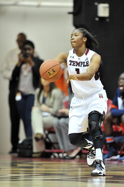 NOVEMBER 16 - PHILADELPHIA: Temple Owls guard Erica Covile (1) passes the ball during the NCAA ladies basketball game against Auburn  November 16, 2013 in Philadelphia