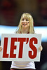 "PHILADELPHIA - JANUARY 26: A Temple cheerleader holds a ""Let's"" sign during a Let's Go chant during an AAC basketball game against Cincinnati January 26, 2013 in Philadelphia."