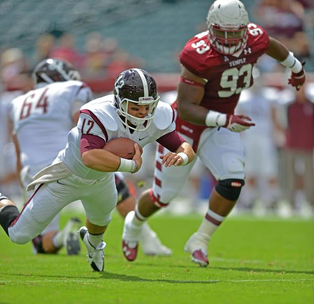 PHILADELPHIA - SEPTEMBER 14: Fordham quarterback Michael Nebrich dives for extra yardage September 14, 2013 in Philadelphia.