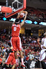 PHILADELPHIA - MARCH 1: Houston forward Danrad Knowles (0) scores on a slam dunk during the AAC basketball game March 1, 2014 in Philadelphia.