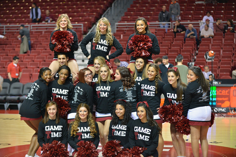 NOVEMBER 11 - PHILADELPHIA: The Temple Owls cheerleaders pause for a photo prior to the NCAA basketball game against Kent State November 11, 2013 in Philadelphia