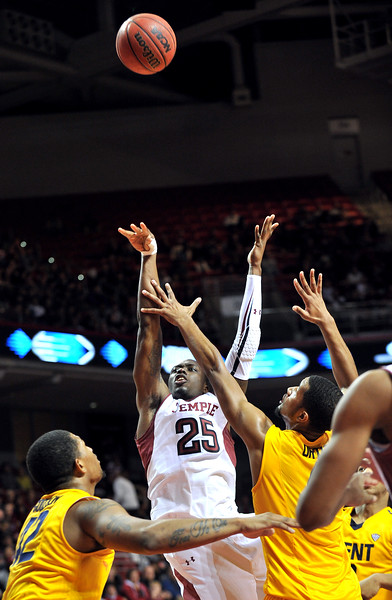 NOVEMBER 11 - PHILADELPHIA: Temple Owls guard Quenton DeCosey (25) releases an off-balance shot during the NCAA basketball game against Kent State November 11, 2013 in Philadelphia
