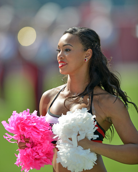 PHILADELPHIA - OCTOBER 5: A Temple Diamond Gems dance team member performs prior to a AAC football game against Temple October 5, 2013 in Philadelphia