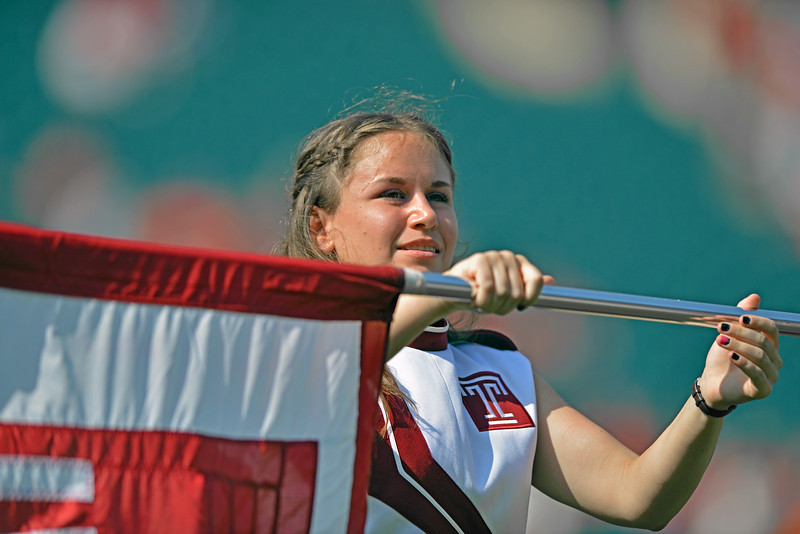 PHILADELPHIA - OCTOBER 5: A member of the Temple marching band color guard performs prior to a AAC football game against Temple October 5, 2013 in Philadelphia