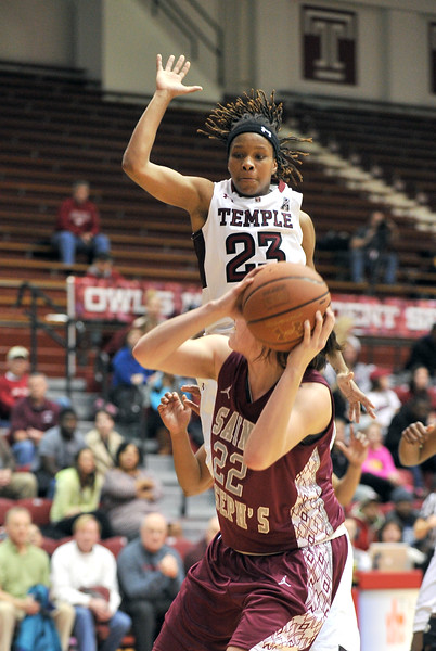 PHILADELPHIA - DECEMBER 4: Temple Owls guard Tyonna Williams (23) goes up in the air on a pump fake in a Big 5 basketball game December 4, 2013 in Philadelphia.