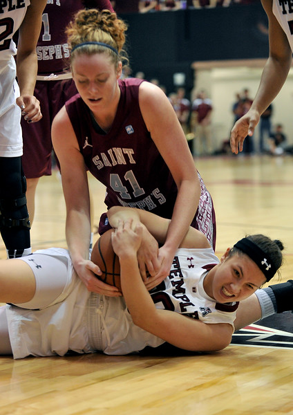 PHILADELPHIA - DECEMBER 4: St. Joseph's (PA) Hawks forward Sarah Fairbanks (41) and Temple Owls guard Meghan Roxas (20) fight for a loose ball in a Big 5 basketball game December 4, 2013 in Philadelphia.