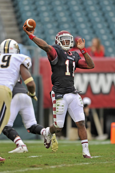 PHILADELPHIA - NOVEMBER 16: Temple quarterback P.J. Walker (11) throws a pass from the pocket during the AAC college football game November 16, 2013 in Philadelphia.