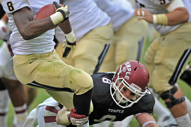 PHILADELPHIA - NOVEMBER 16: Temple linebacker Tyler Matakevich (8) goes low to tackle a UCF ball carrier during the AAC college football game November 16, 2013 in Philadelphia.