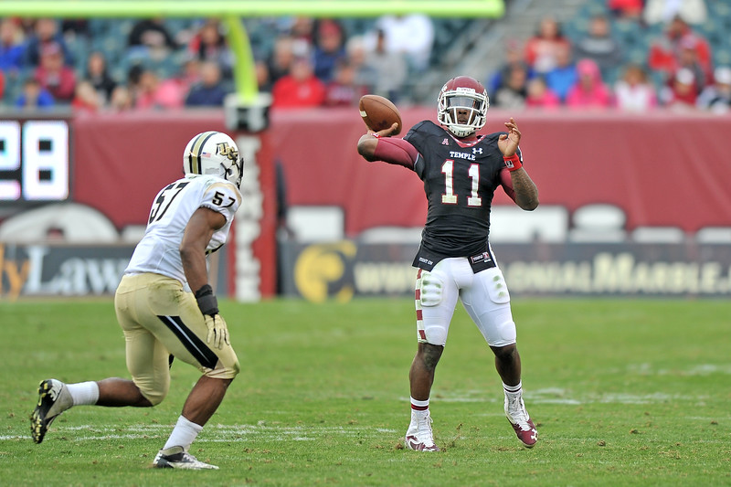 PHILADELPHIA - NOVEMBER 16: Temple quarterback P.J. Walker (11) throws on the run during the AAC college football game November 16, 2013 in Philadelphia.