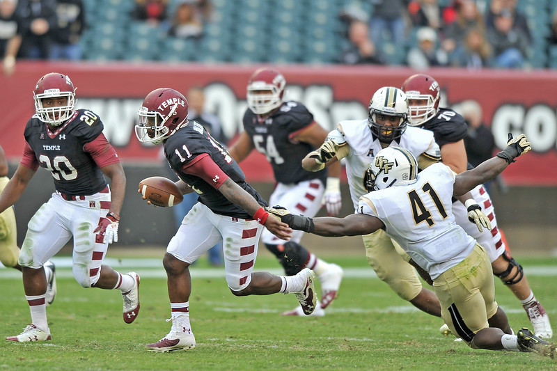 PHILADELPHIA - NOVEMBER 16: Temple quarterback P.J. Walker (11) runs away from pressure during the AAC college football game November 16, 2013 in Philadelphia.