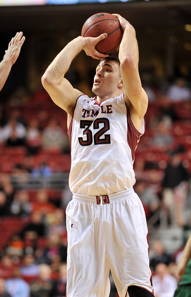 PHILADELPHIA - JANUARY 9: Temple Owls guard Dalton Pepper (32) shoots a jumper during the AAC basketball game January 9, 2014 at the Liacouras Center in Philadelphia.