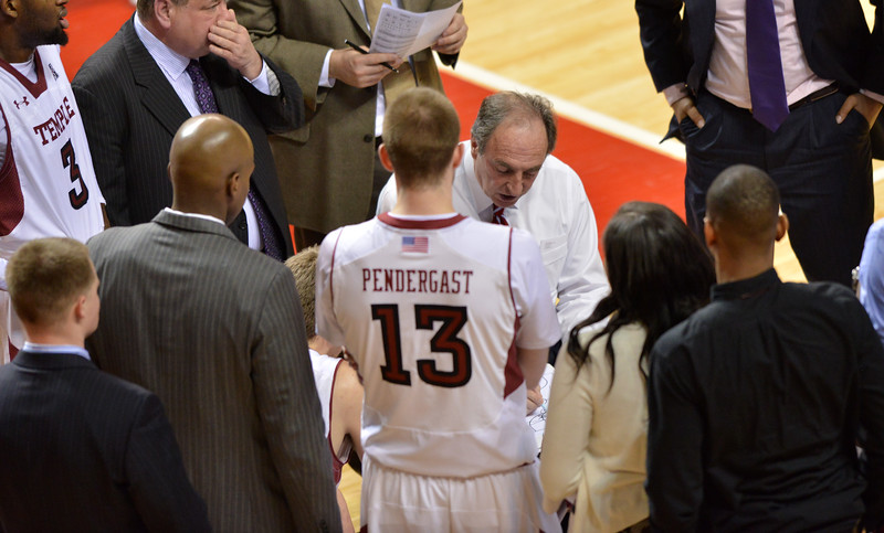 PHILADELPHIA - JANUARY 9: Temple Owls head coach Fran Dunphy (center) diagrams a play during a time-out in the AAC basketball game January 9, 2014 at the Liacouras Center in Philadelphia.