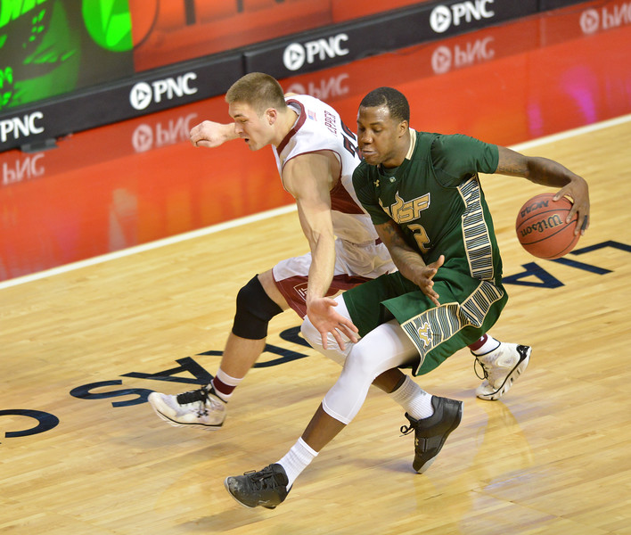 PHILADELPHIA - JANUARY 9: South Florida Bulls forward Victor Rudd (2) controls a loose ball in the backcourt during the AAC basketball game January 9, 2014 at the Liacouras Center in Philadelphia.