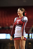 PHILADELPHIA - JANUARY 9: A Temple cheerleader performs a stunt during the AAC basketball game January 9, 2014 at the Liacouras Center in Philadelphia.