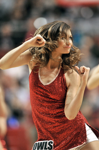 PHILADELPHIA - DECEMBER 4: A Temple Diamond Gems dance team member performs during the Big 5 basketball game December 4, 2013 in Philadelphia.