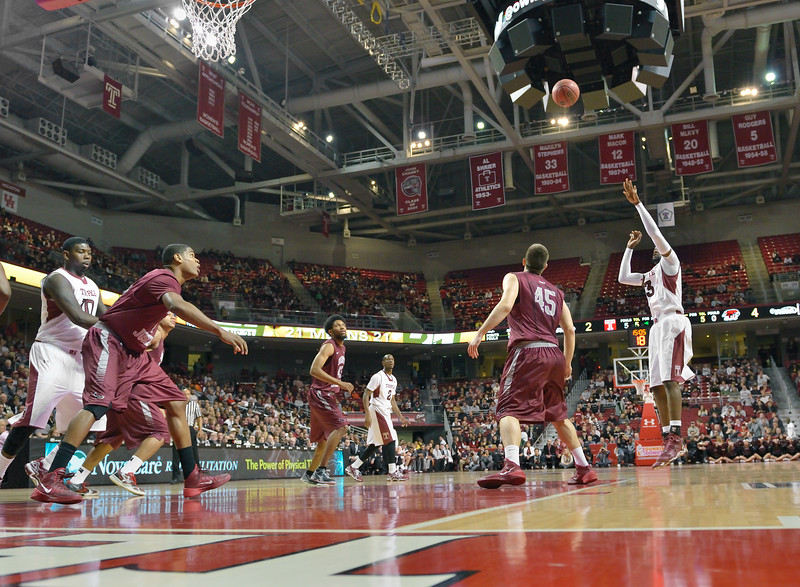 PHILADELPHIA - DECEMBER 4: Temple Owls forward Anthony Lee (3) puts up a short jump shot in the Big 5 basketball game December 4, 2013 in Philadelphia.