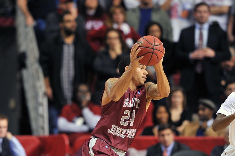 PHILADELPHIA - DECEMBER 4: Saint Joseph's Hawks guard Chris Wilson (24) catches a pass in the Big 5 basketball game December 4, 2013 in Philadelphia.