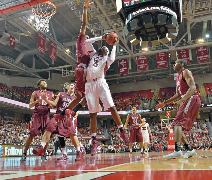 PHILADELPHIA - DECEMBER 4: Temple Owls forward Anthony Lee (3) puts up a shot as a St. Joe's defender tries for the block in the Big 5 basketball game December 4, 2013 in Philadelphia.