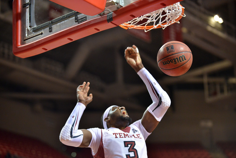 PHILADELPHIA - DECEMBER 18: Temple Owls forward Anthony Lee (3) completes a dunk in the NCAA basketball game December 18, 2013 in Philadelphia.