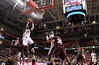 PHILADELPHIA - DECEMBER 18: Temple Owls guard Quenton DeCosey (25) hangs in the air taking a shot in the NCAA basketball game December 18, 2013 in Philadelphia.