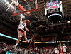 PHILADELPHIA - DECEMBER 18: Temple Owls guard Dalton Pepper (32) completes a slam dunk on a fast break in the NCAA basketball game December 18, 2013 in Philadelphia.