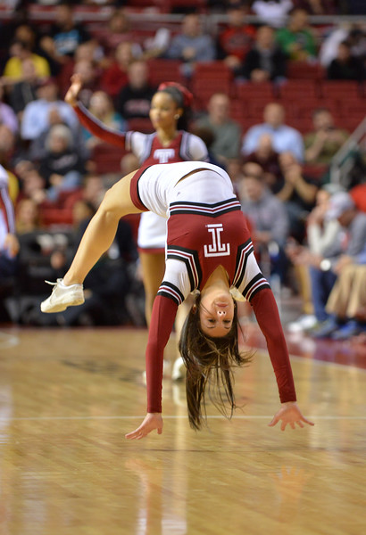 PHILADELPHIA - DECEMBER 18: A Temple cheerleader performs a tumbling run in the NCAA basketball game December 18, 2013 in Philadelphia.