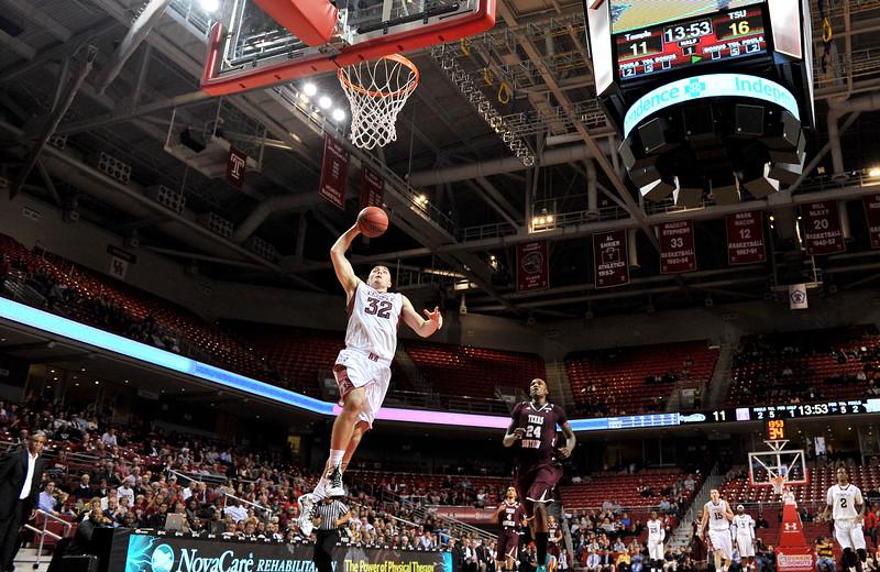 PHILADELPHIA - DECEMBER 18: Temple Owls guard Dalton Pepper (32) takes off en route to a slam dunk on a fast break in the NCAA basketball game December 18, 2013 in Philadelphia.