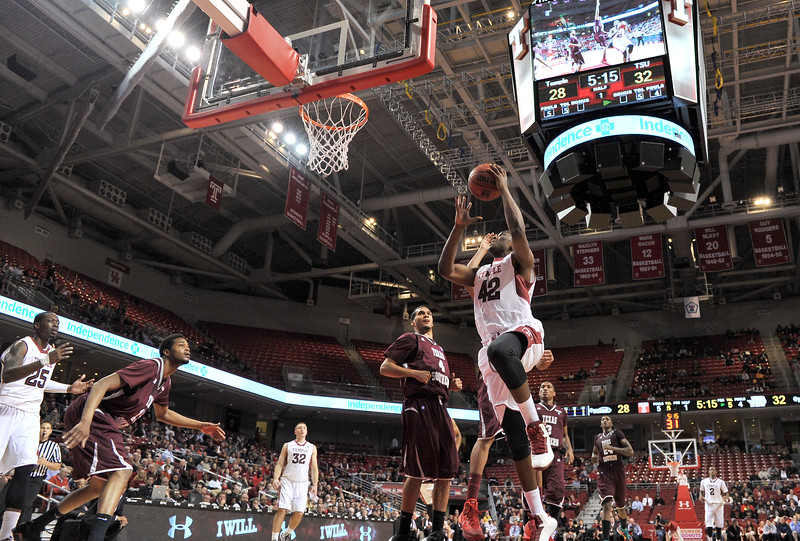 PHILADELPHIA - DECEMBER 18: Temple Owls guard/forward Daniel Dingle (42) goes in for a shot in the NCAA basketball game December 18, 2013 in Philadelphia.