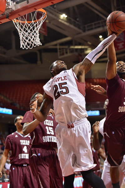 PHILADELPHIA - DECEMBER 18: Temple Owls guard Quenton DeCosey (25) fights for a rebound in the NCAA basketball game December 18, 2013 in Philadelphia.