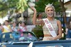 Miss Dixie Laura Lee Lewis waves to the crowd on Monday, June 20, 2016, while riding in the Miss Mississippi Pageant Parade down Washington Street in downtown Vicksburg, Miss.