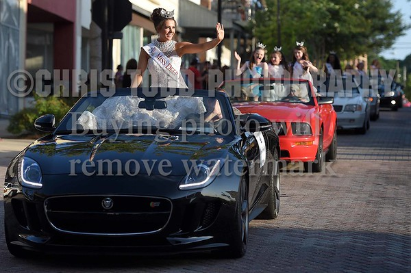 Miss Deep River Mia Hall waves to the crowd on Monday, June 20, 2016, while riding in the Miss Mississippi Pageant Parade down Washington Street in downtown Vicksburg, Miss.