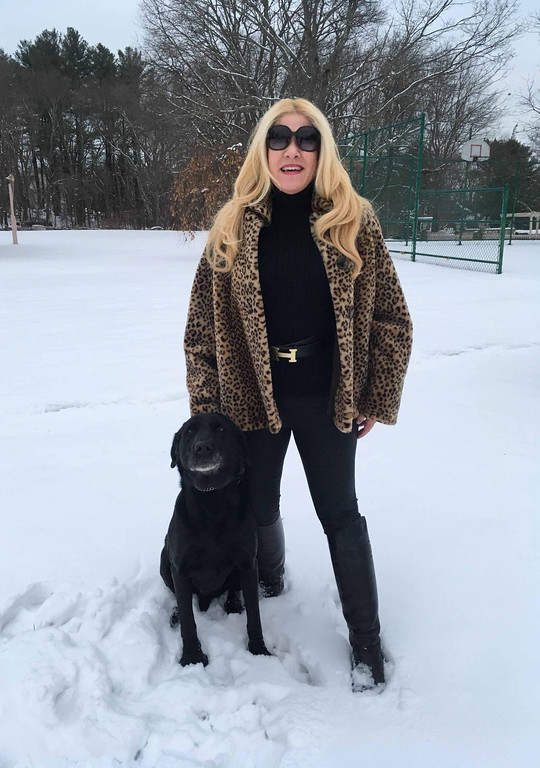 . Black Magic: Standing with this magical top dog, Blacky, I�m wearing a vintage leopard faux-fur swing coat, a pair of leather leggings, Chanel Equestrian riding boots, and a pair of black Gucci sunglasses! Special thank you to my goddaughter, Despena Zouzas, for taking this great pic of me and her family dog, Blacky!Handed Illusionists Steve Kradolfer and Joel Acevedo
