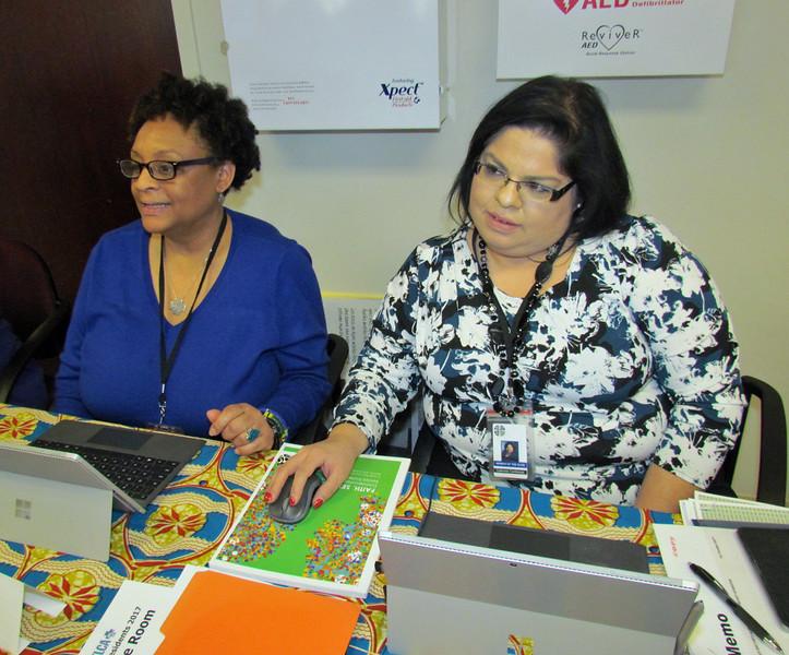 Eva Yeo, left, and Gabriela Contreras help a president