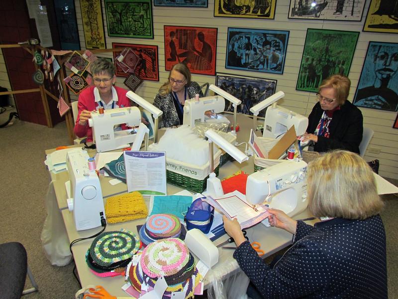 Executive Board Secretary Becky Shurson and presidents sewing labyrinths