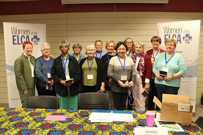 Patti Austin, Women of the ELCA executive board president, left, welcomes new presidents